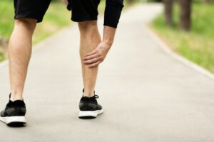 Male runner is suffering from calf pain on jogging
