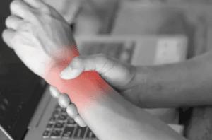 man-holding-her-wrist-pain