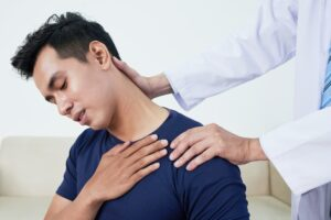 Patient sufering from neck pain